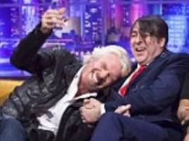 sir richard branson pours a cup of water over jonathan ross's head