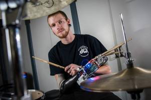 robotic arm turns man into a cyborg drummer
